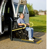 disabled man in a wheelchair lift