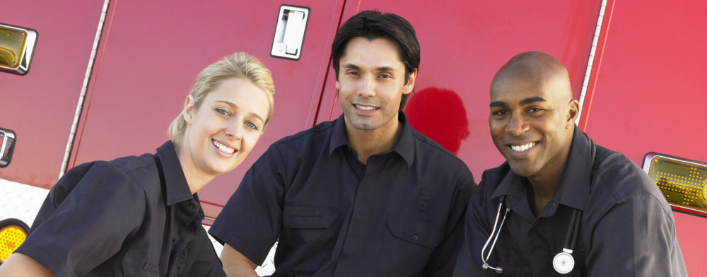 three paramedics smiling