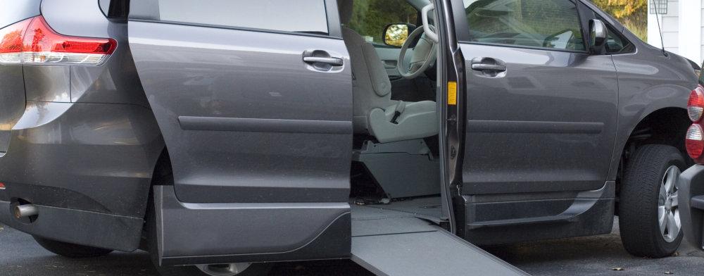 grey van with lifter