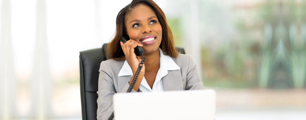receptionist using telephone