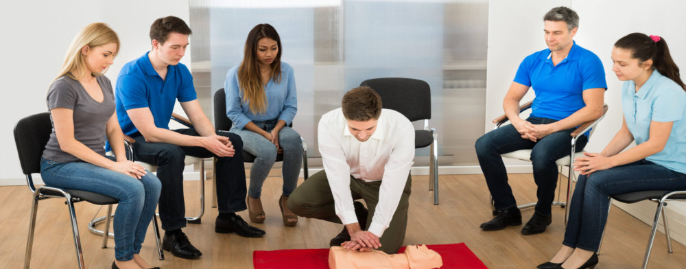 group of people watching in CPR training